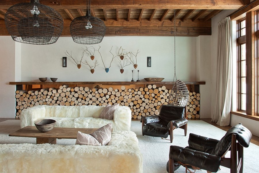 Ingenious firewood storage complements the low slung style of the room