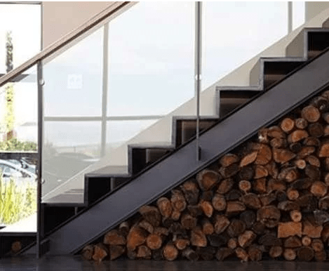 Firewood storage under stairs