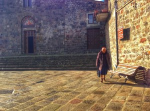 Nonna in front of San Pietro Church in Radicofani
