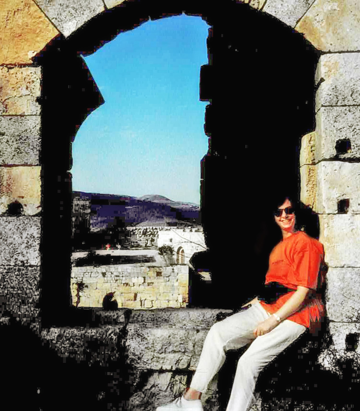 Ruined castle window with woman seated