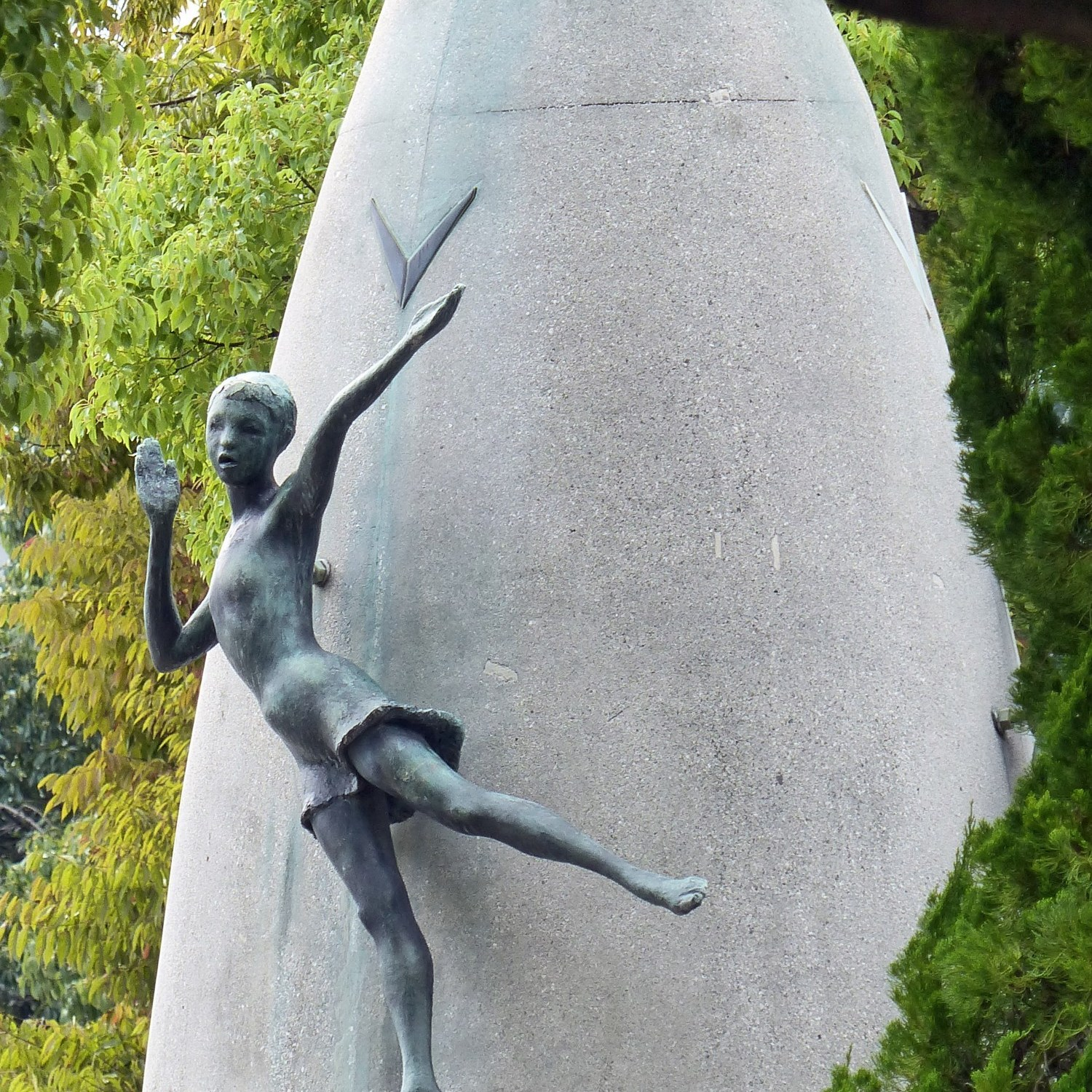 Monument with bronze figure of a girl
