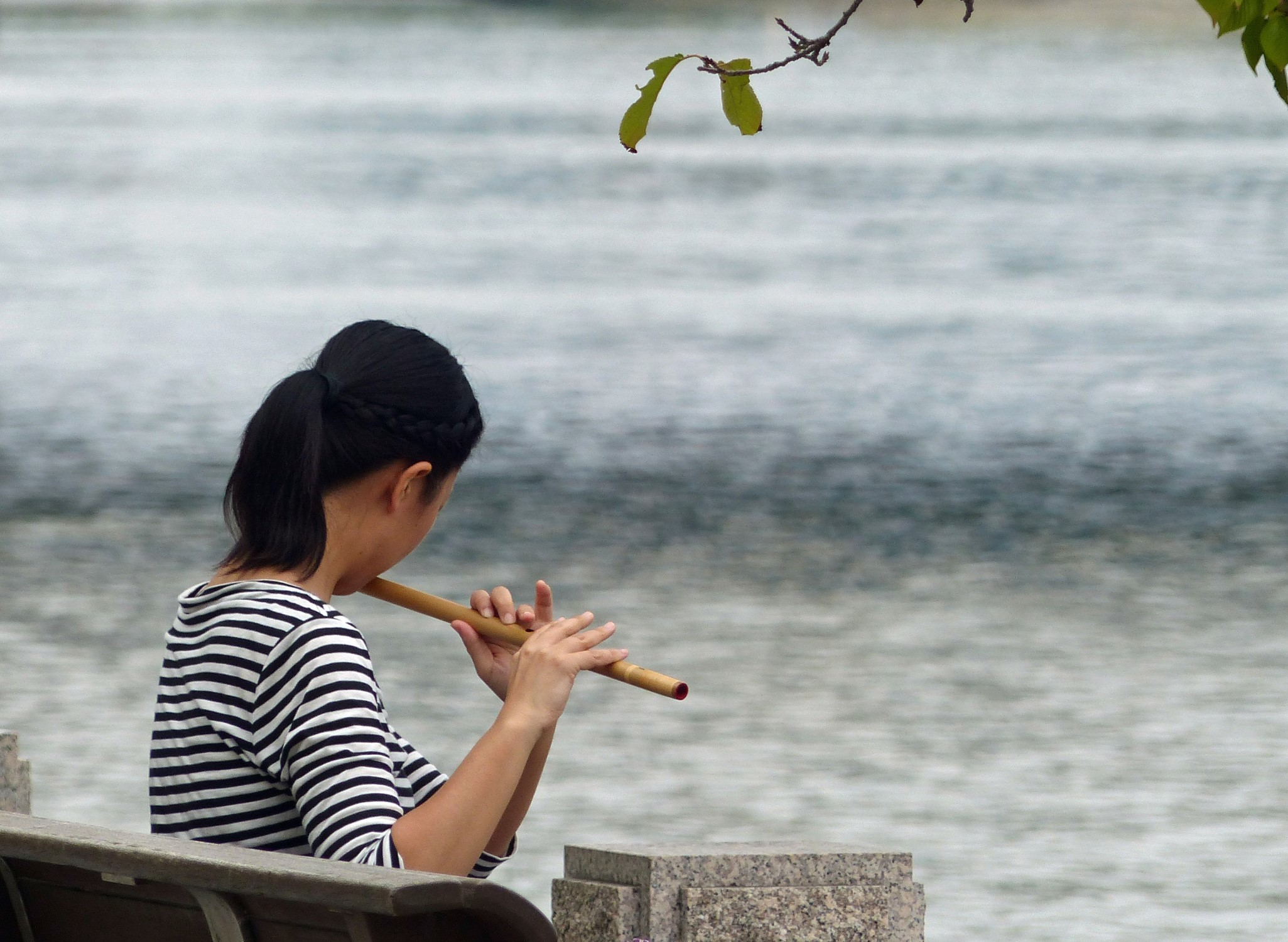 Young girl playing a flute