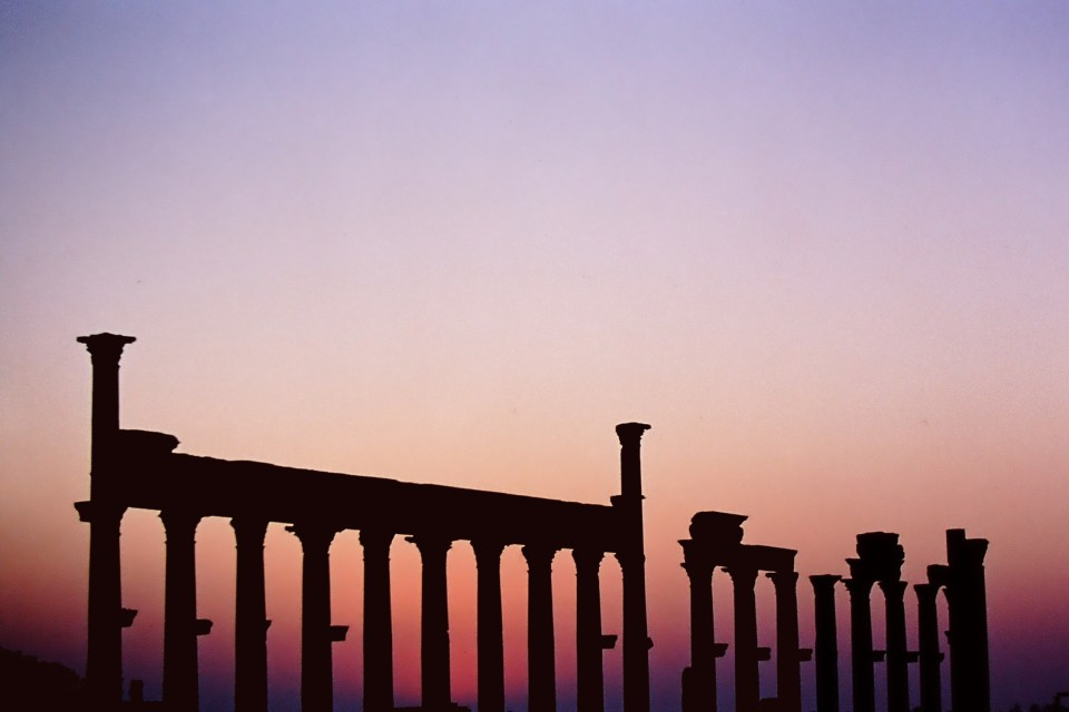 Roman columns against a sunset sky