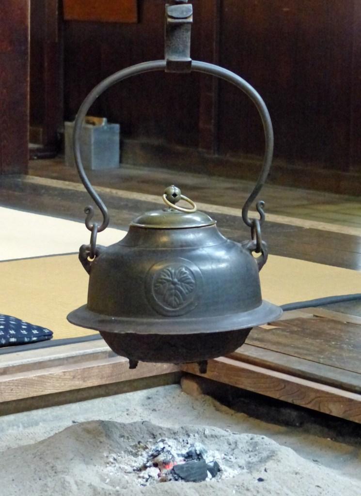 Iron pot hanging above a fireplace