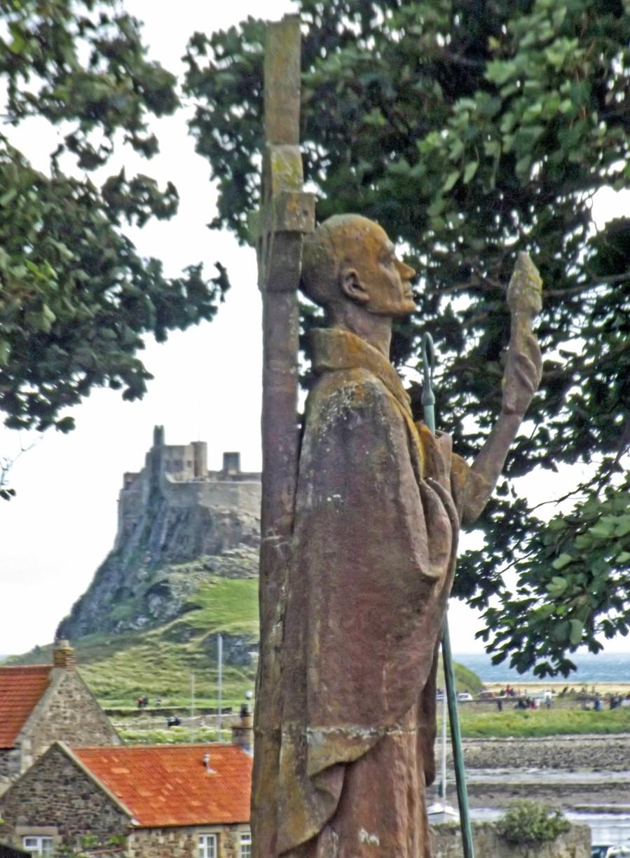 Statue of a saint and distant castle