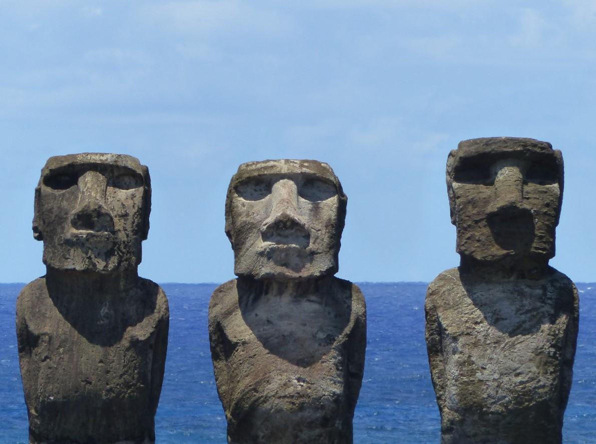 Three moai, with the sea behind