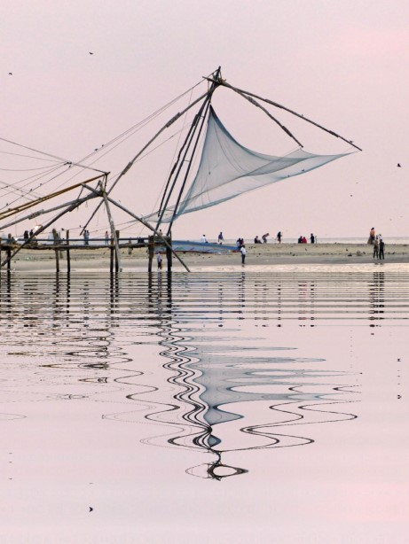 Fishing nets with pink sky and reflection