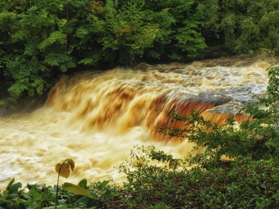 Brown-tinged waterfall