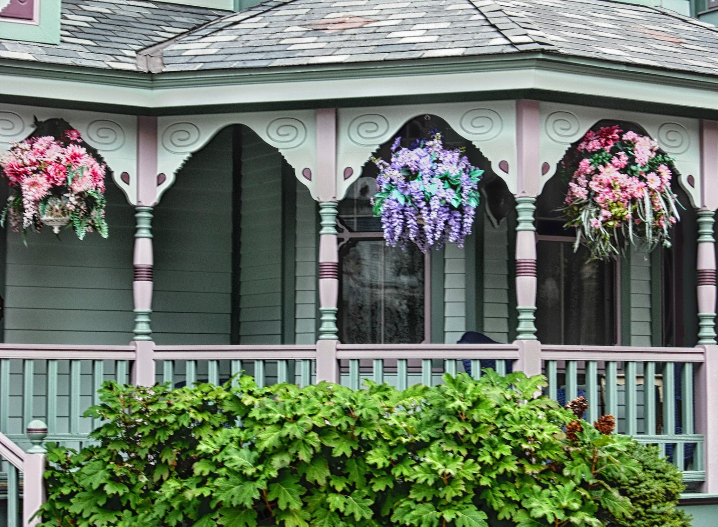 Victorian house porch with hanging baskets
