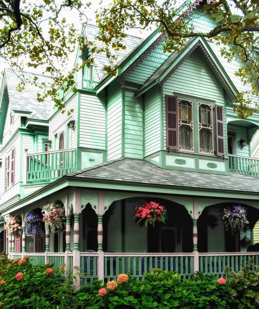 Green Victorian house with porch