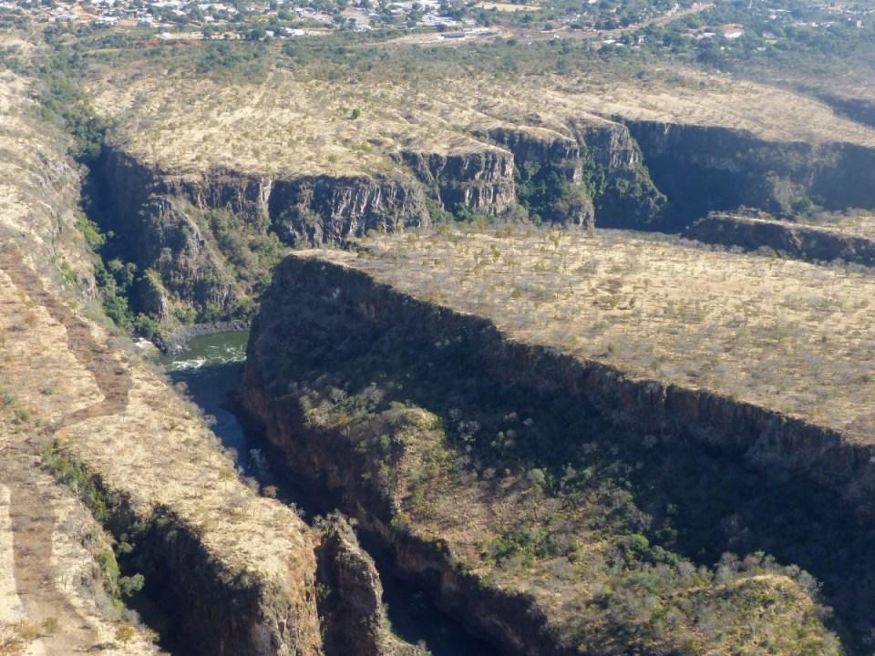 Gorge cutting through a grassy plain