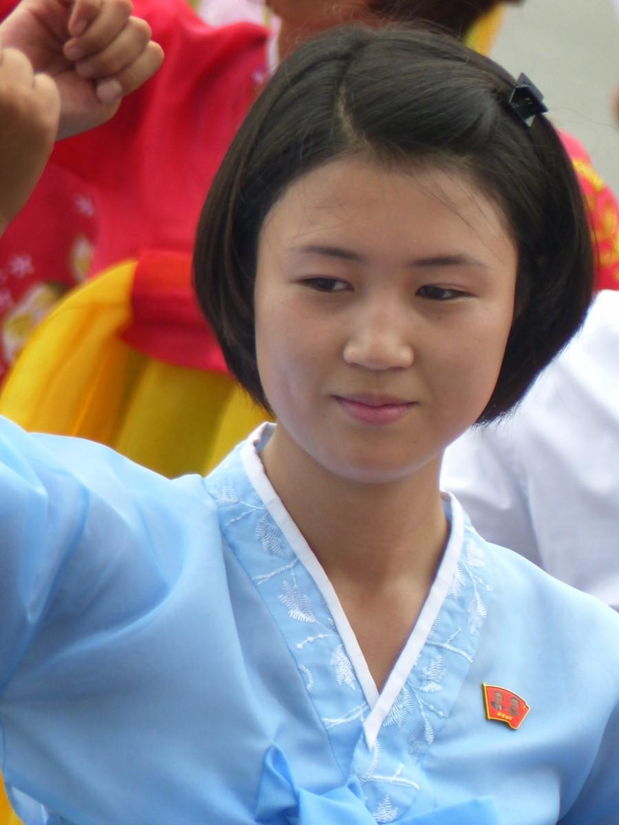 Woman dancing in traditional Korean blue dress
