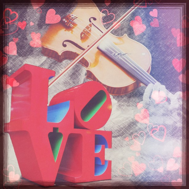 Composite photo of Love sculpture and violin