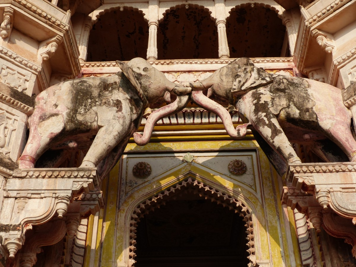 Looking up at large gate with elephant carvings