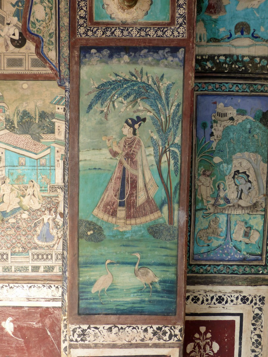 Wall painting of girl and birds