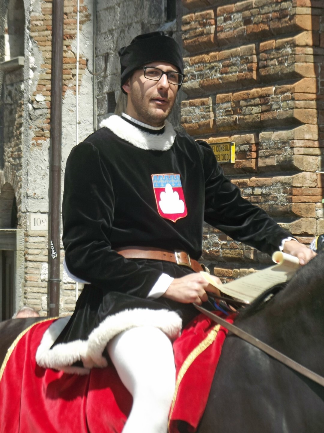 Man in medieval dress on a horse