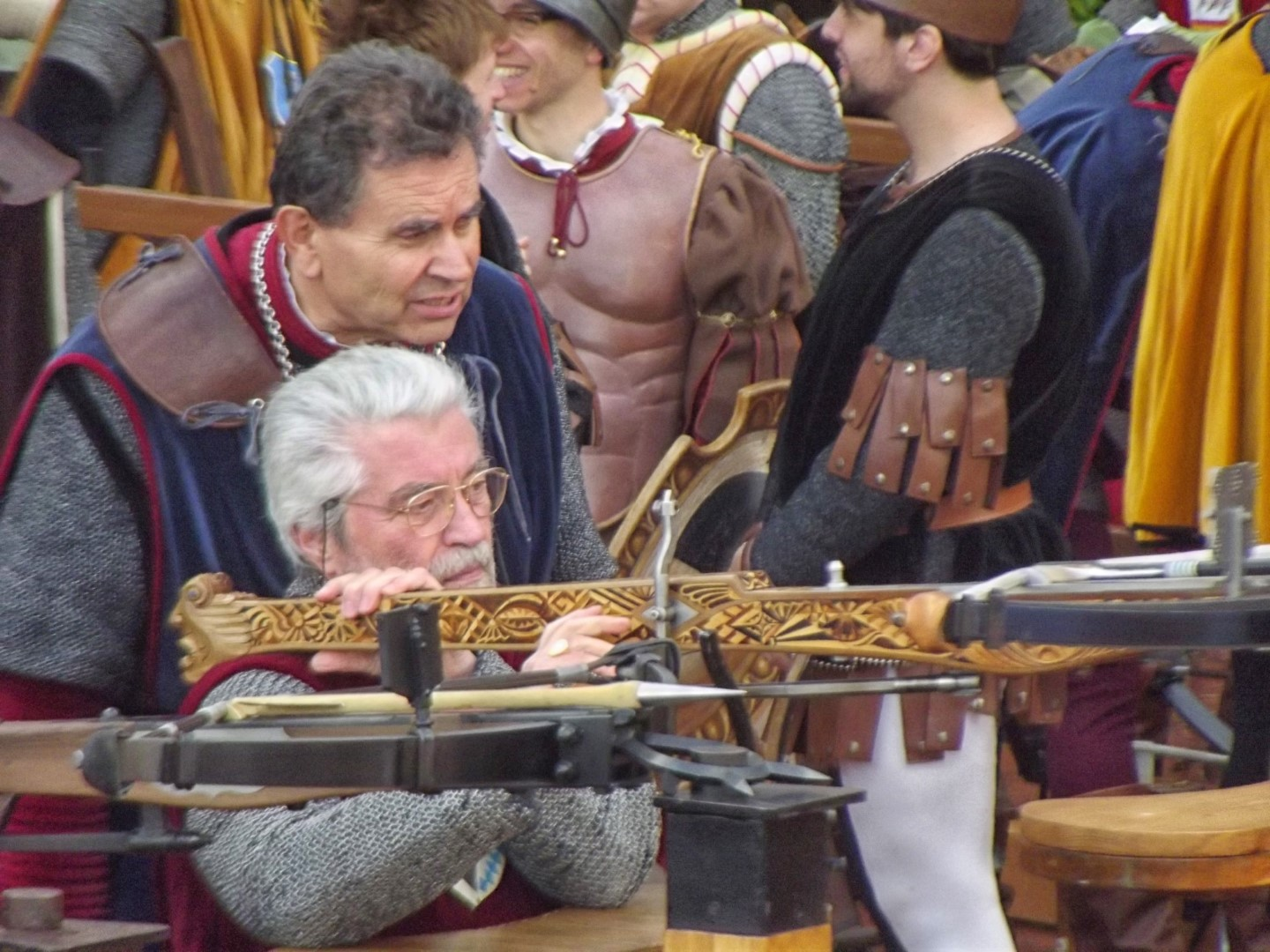 Two men with a cross bow