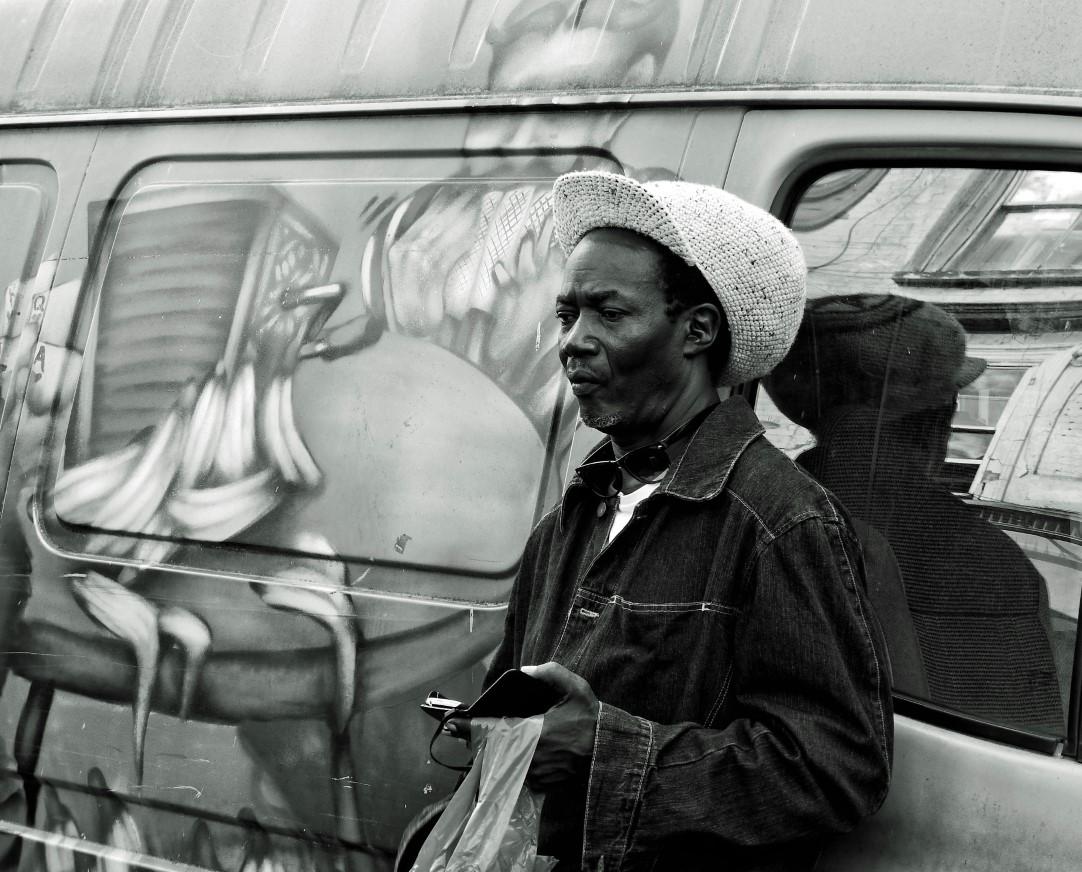 Man leaning against a van