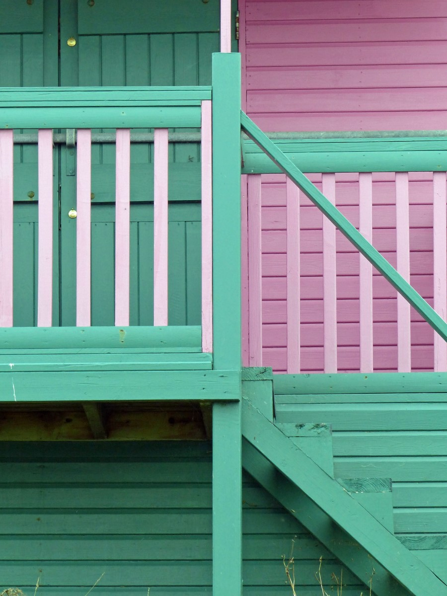 Wooden hut detail, pink and green