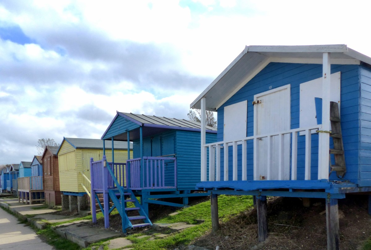 Row of wooden huts painted blue and yellow