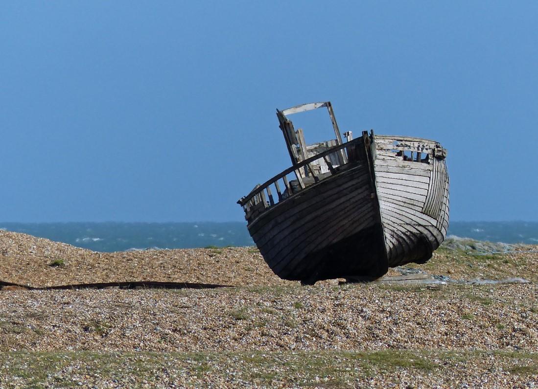 Old boat on a shingle beach