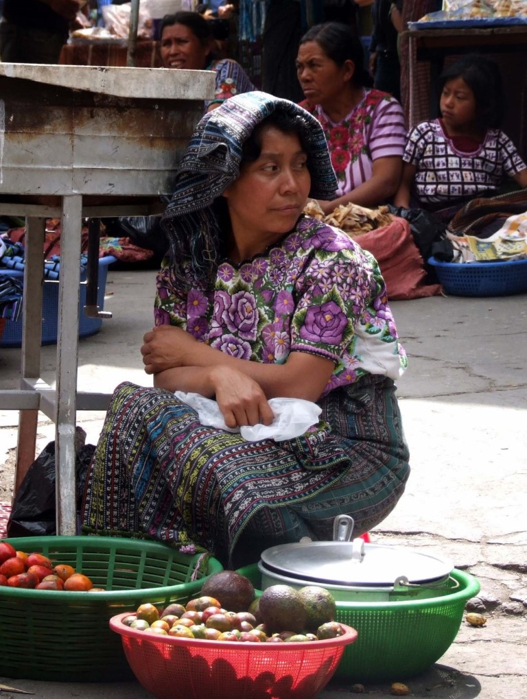 Woman with baskets of vegetables