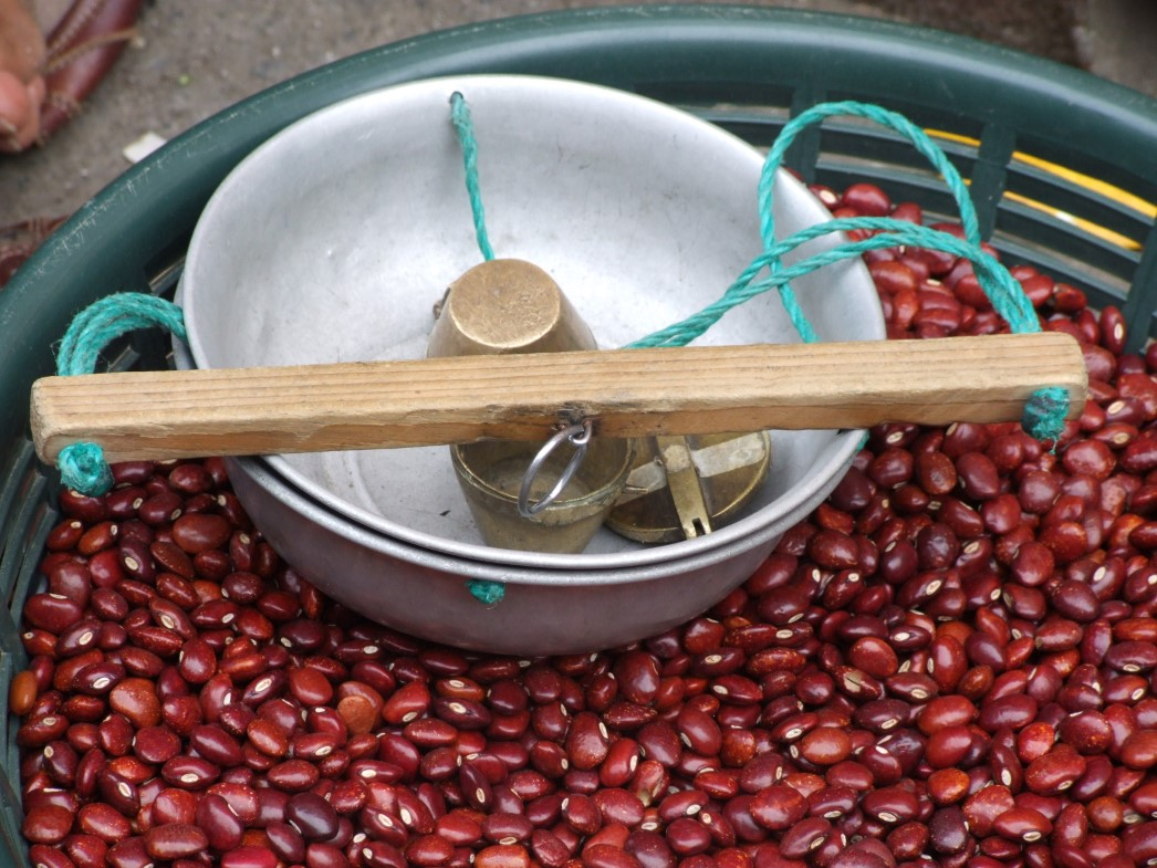 Red beans in a bowl and simple scales
