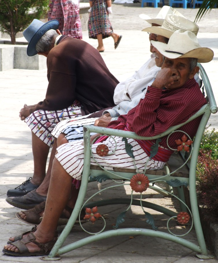 Men on a bench in short striped trousers
