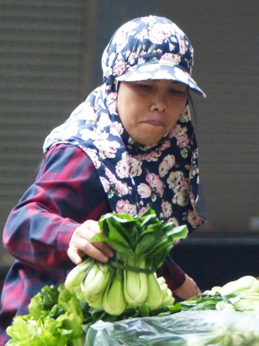 Lady selling vegetables