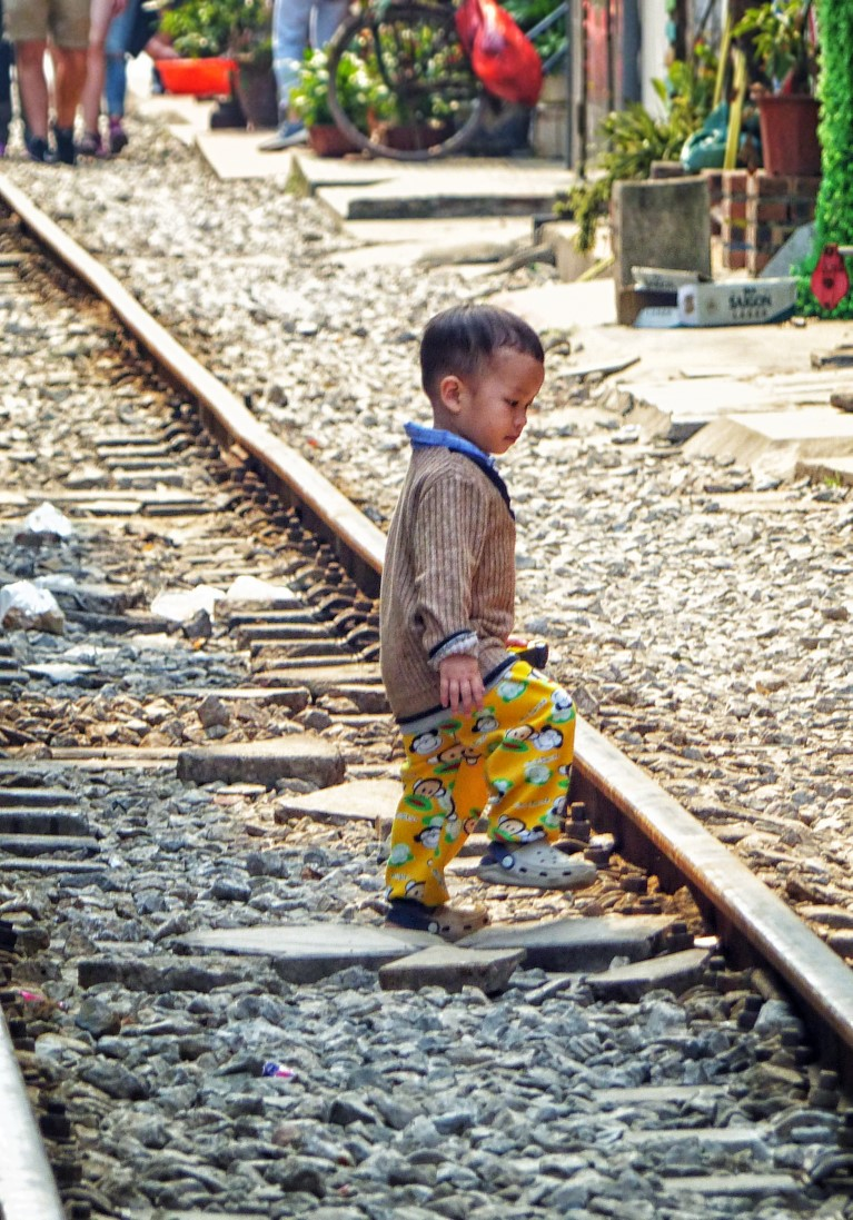 Toddler on train track