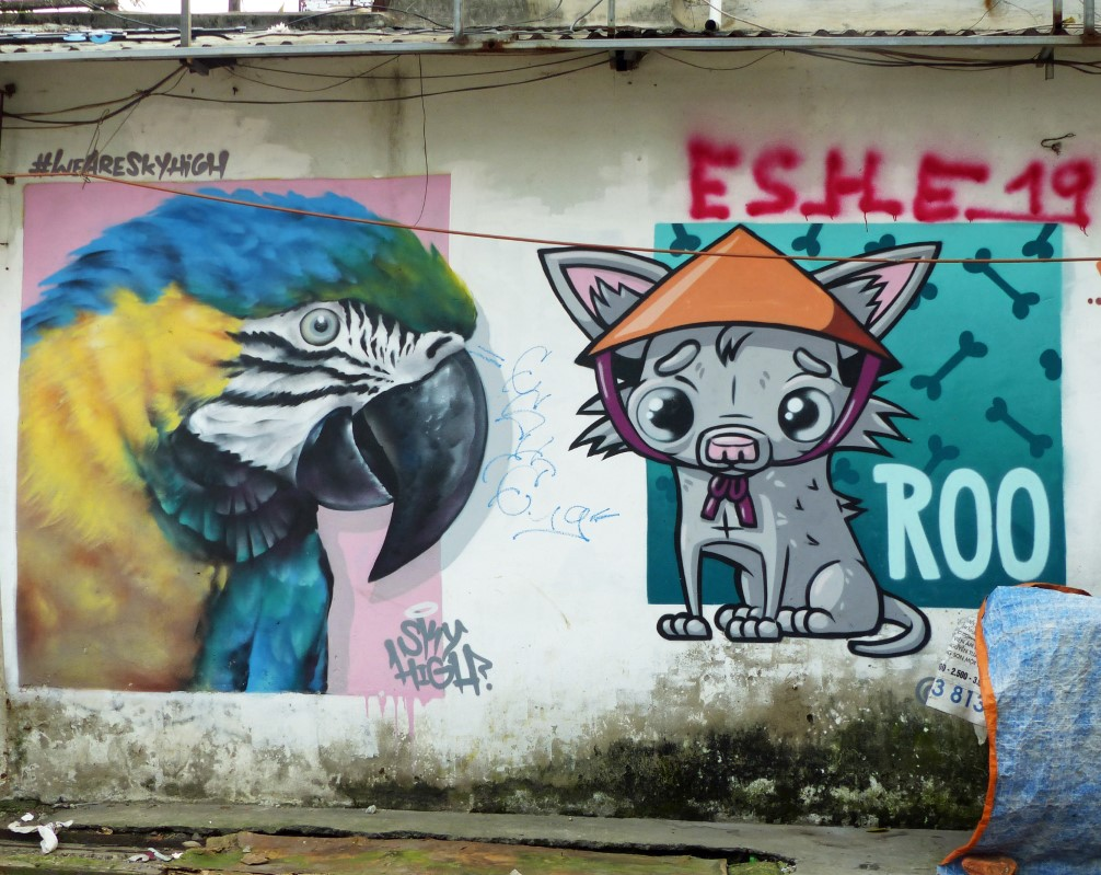 Mural of parrot and small dog in a hat
