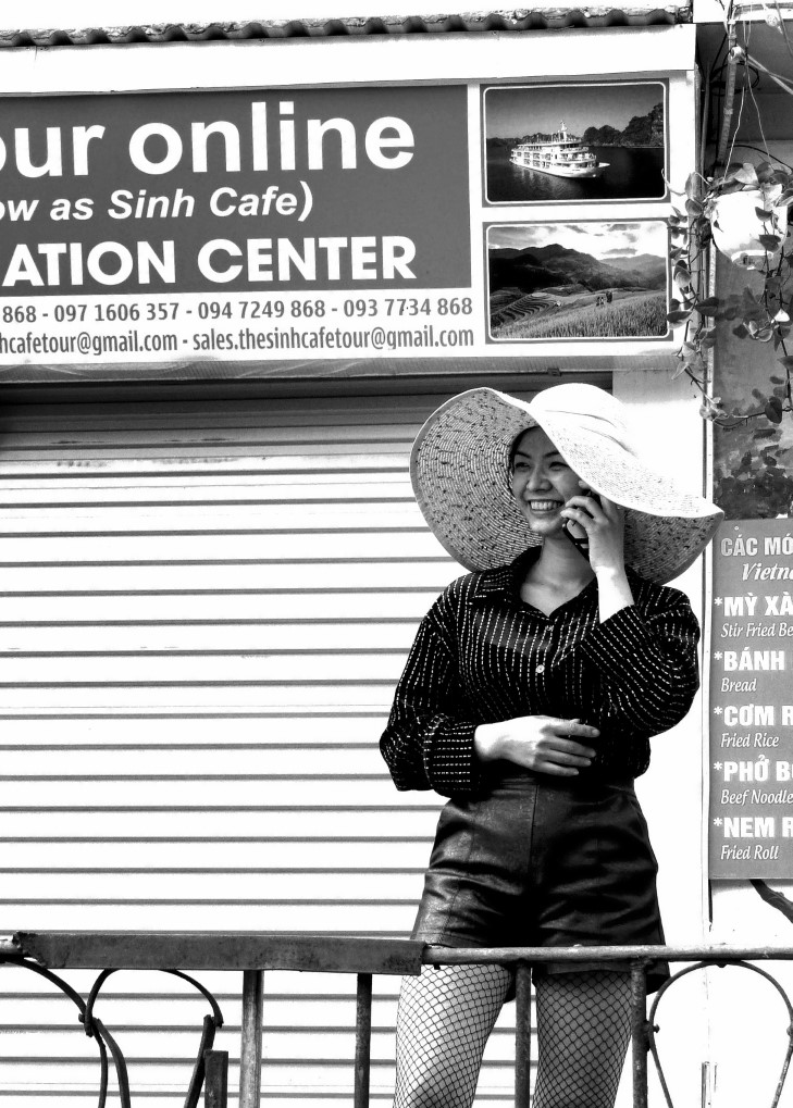 Young lady with large straw hat talking on phone