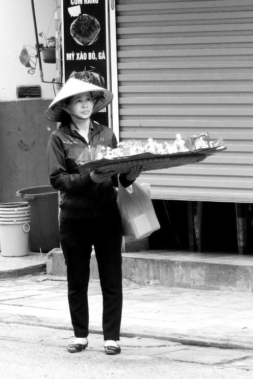 Lady with large tray selling goods