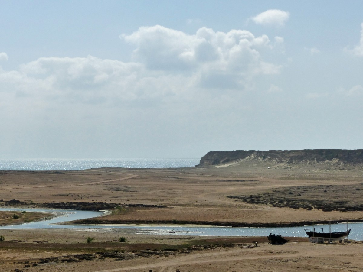 Dry landscape with river and sea beyond