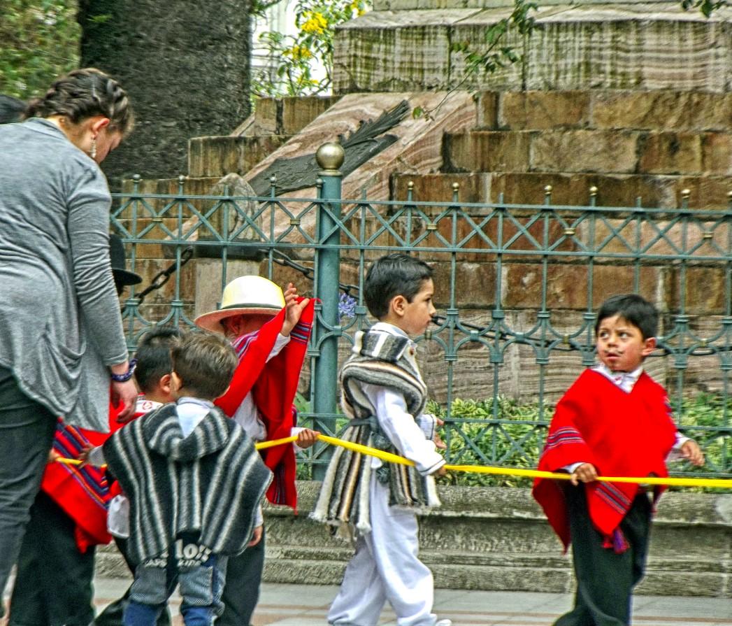 Small boys in ponchos