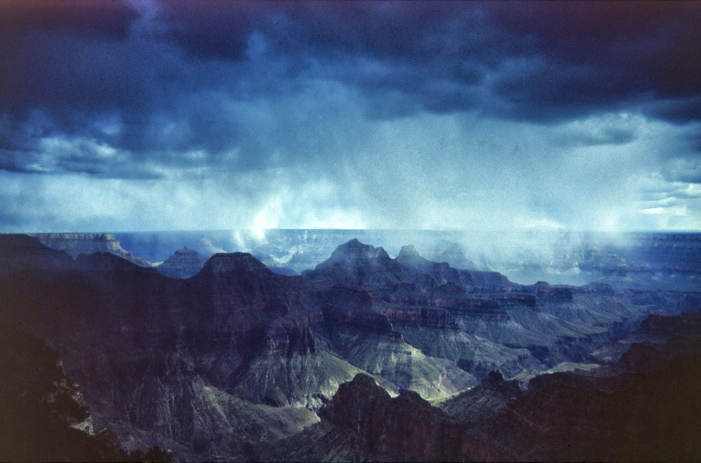 Dramatic landscape with dark blue clouds