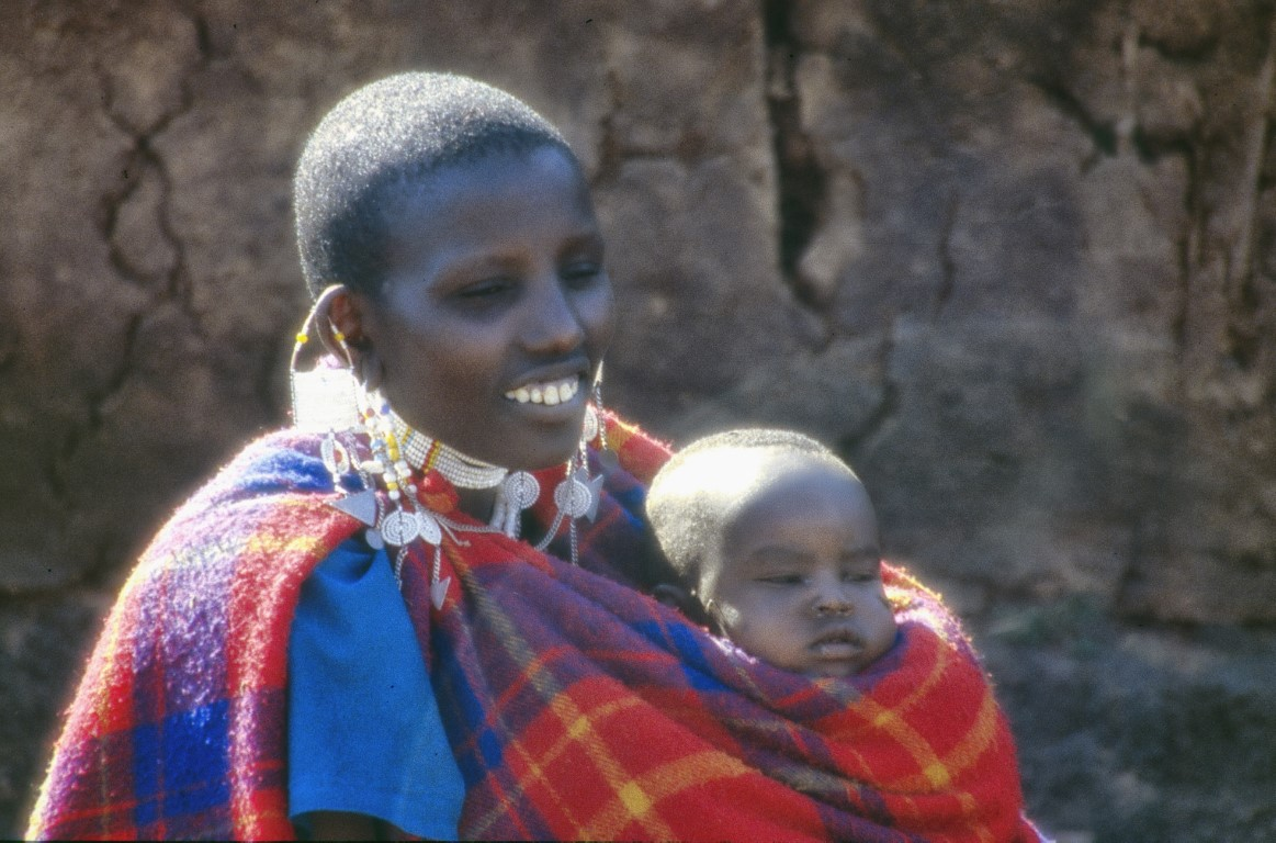 Mother and baby wrapped in red blanket