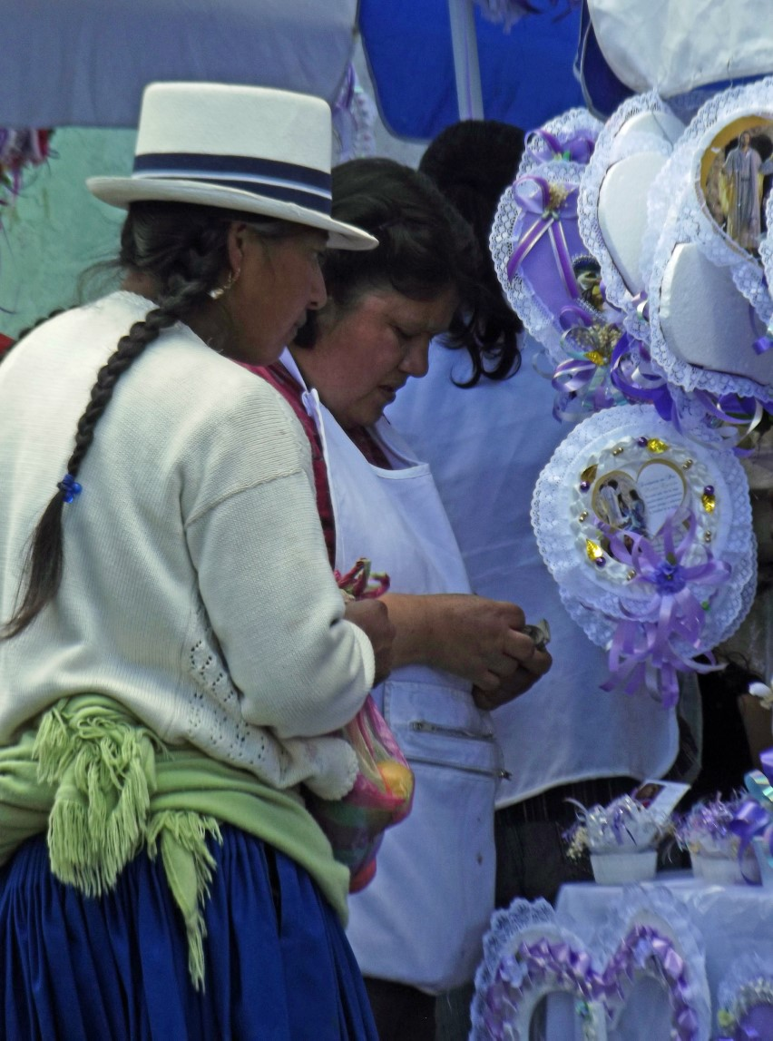 Two women at stall selling decorations