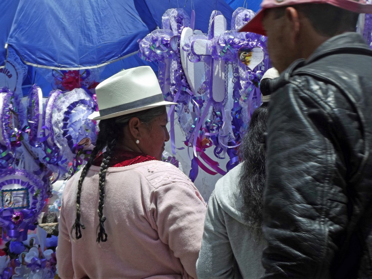 People at stall selling decorations