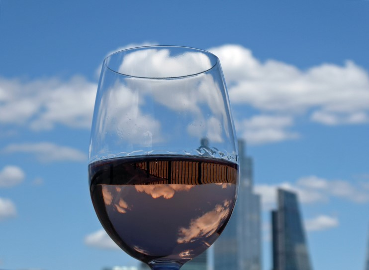 Glass of rose wine with skyscrapers behind