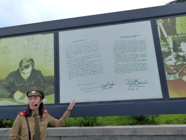 Lady in military uniform by display boards