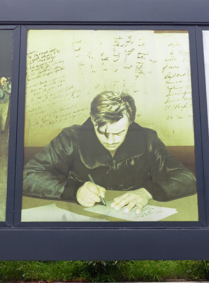 Photo of man signing a letter