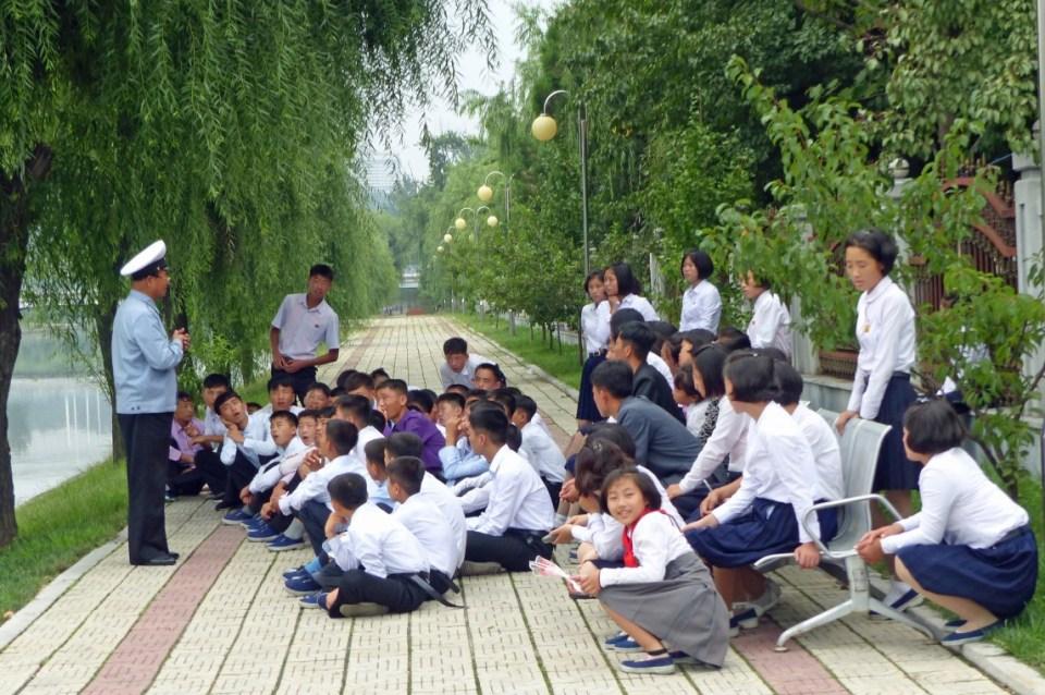 School children in uniform with red ties