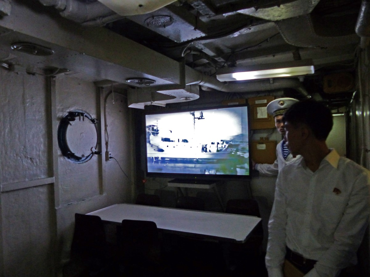Dark room with video showing on a screen
