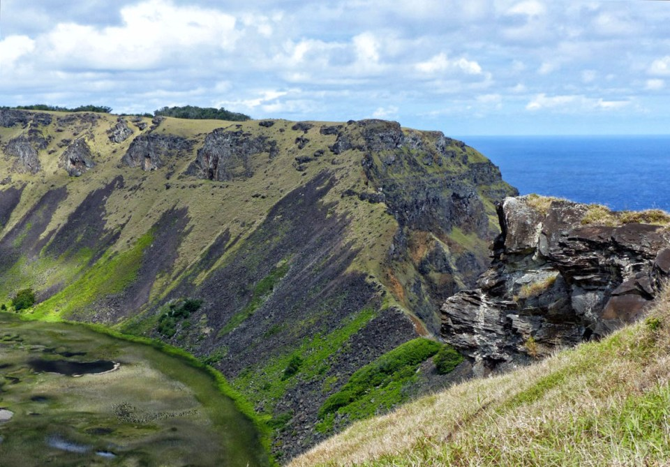 Part of volcanic crater and sea beyond