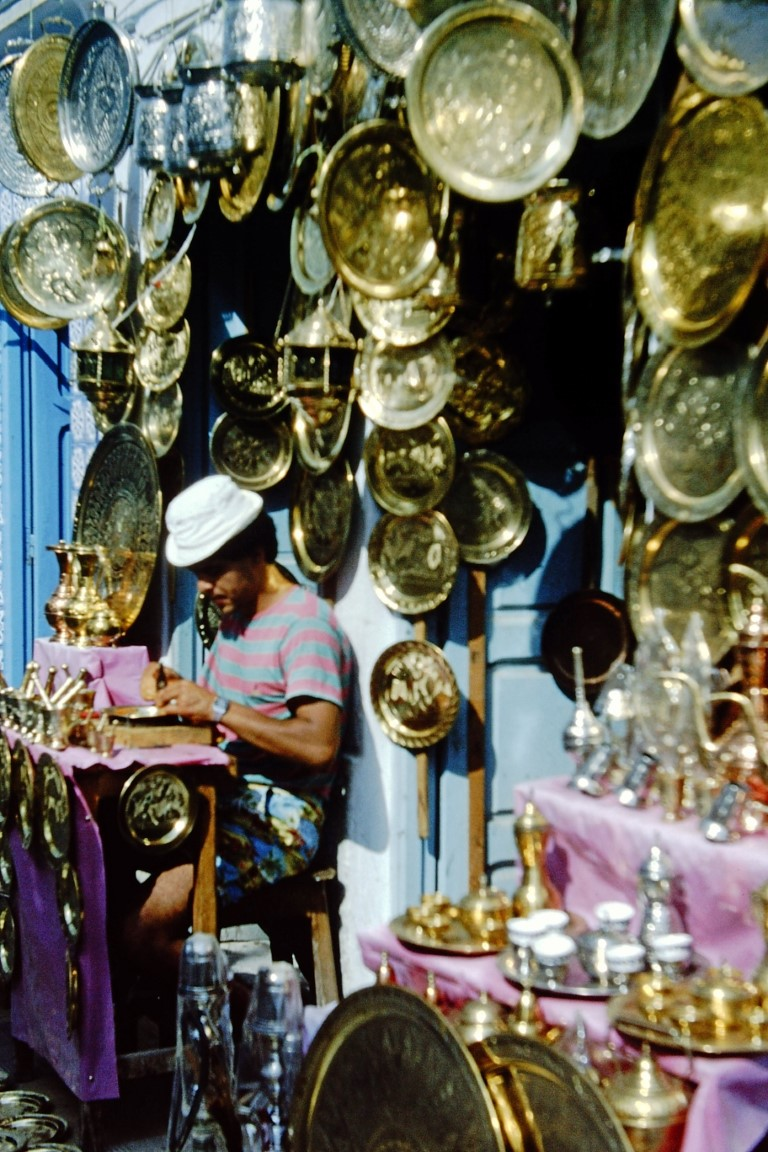 Metal-worker at his stall selling platters