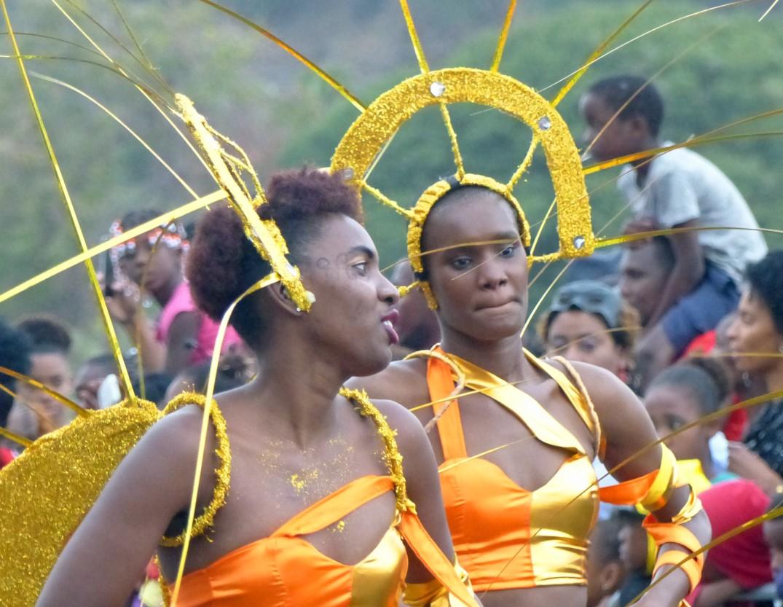 Women in bright orange carnival costumes