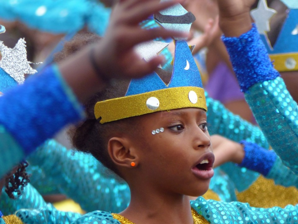 Young girl in bright carnival costume