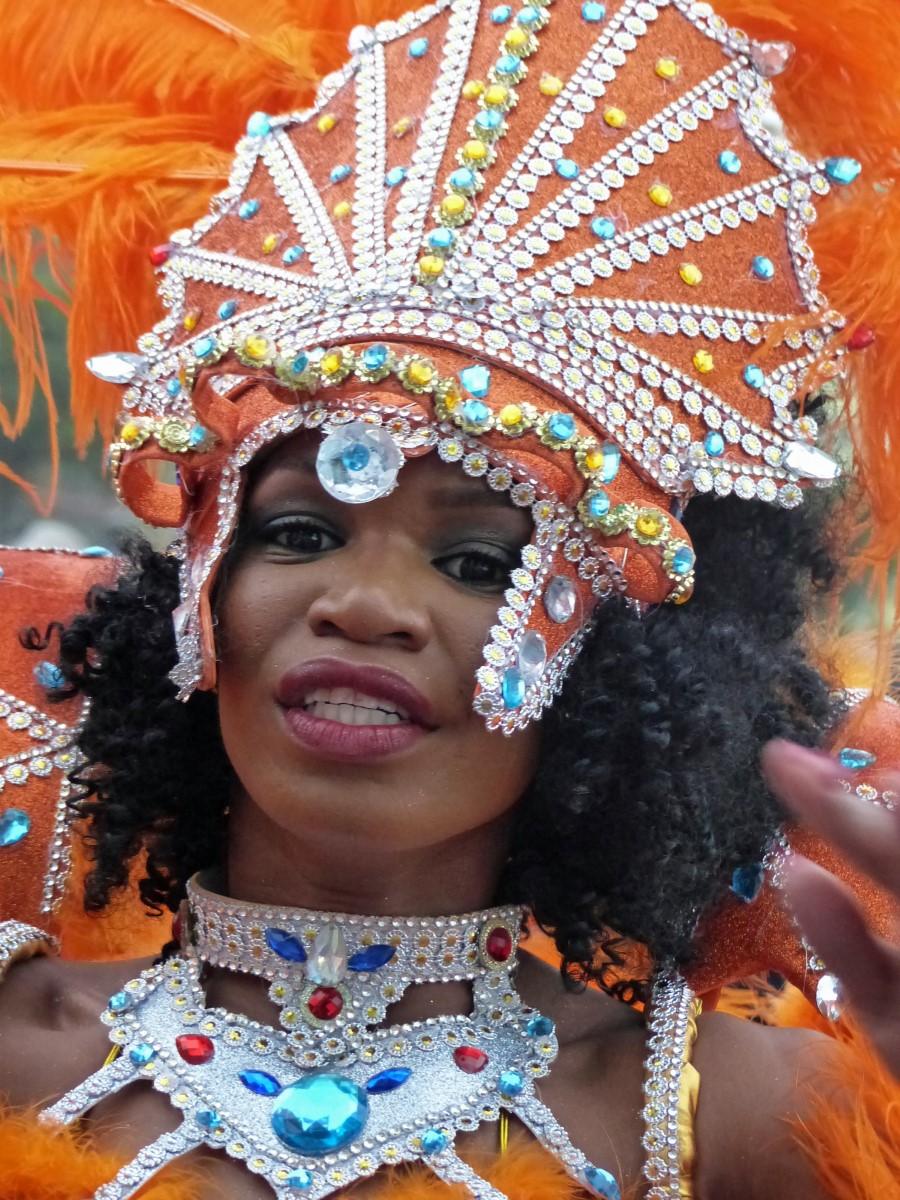 Lady in bright orange carnival costume