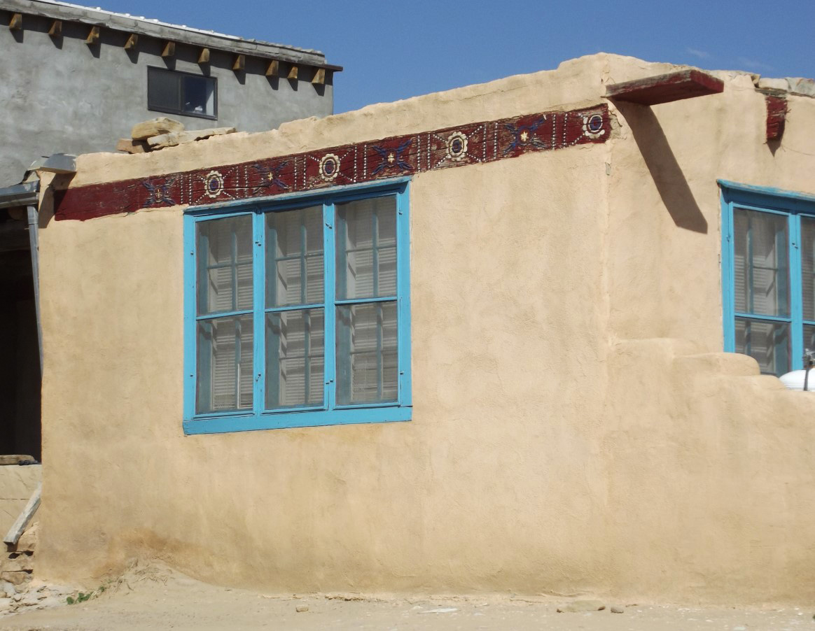 Adobe house with turquoise windows